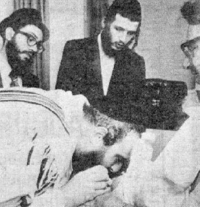 A Jewish circumcision, with the Mohel sucking blood from the baby's penis